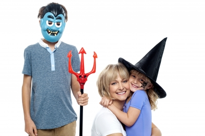 Family celebrating Halloween. Image courtesy of stockimages at FreeDigitalPhotos.net